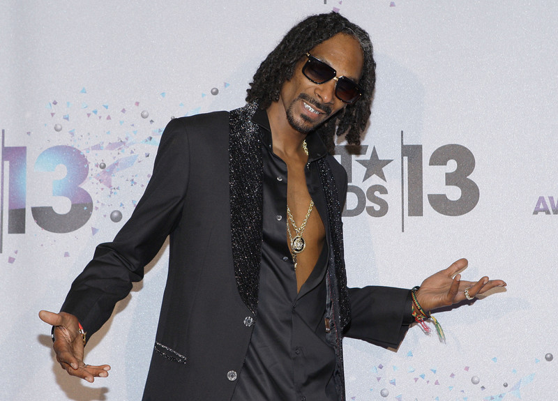 . Rapper Snoop Lion (formerly Snoop Dogg) poses in the Backstage Winner\'s Room at Nokia Theatre L.A. Live on June 30, 2013 in Los Angeles, California.  (Photo by Mike Windle/Getty Images for BET)