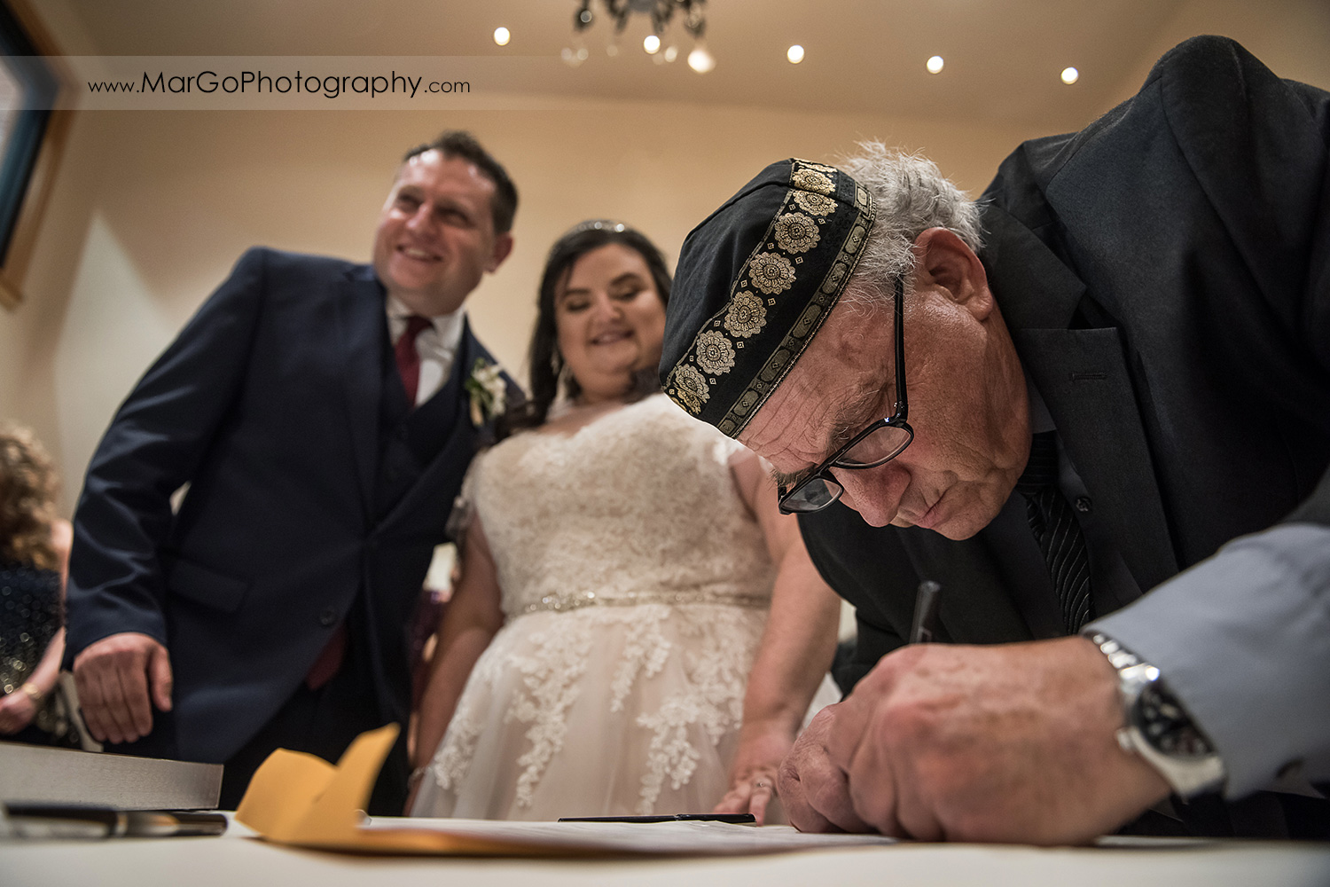 ketubah signing during jewish wedding ceremony at Livermore Garre Vineyard and Winery