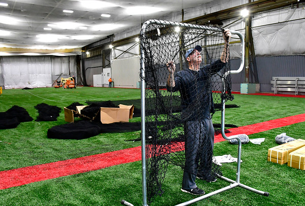 3/7/2019 Mike Orazzi | Staff Bob Turcio works on netting inside a new multi-sport facility in Plainville called All Access Sports on Neal Court.