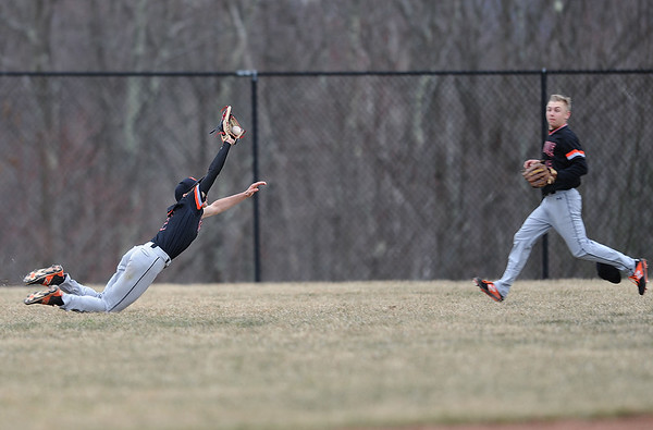 4/11/2019 Mike Orazzi | Staff Terryville's Sean O'Donnell (7) makes a diving catch in center field during Thursday's baseball game with Thomason at Terryville High School.