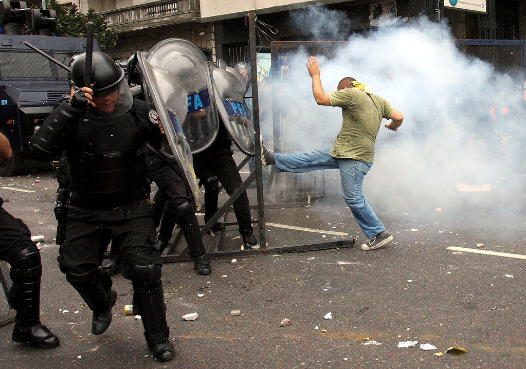 . A student of the Buenos Aires University Union Federation (FUBA) kicks a barrier in front of the Congress in Buenos Aires, December 14, 2009, amid clashes with riot police during a protest staged to avoid an assembly to elect the new rector of the university. REUTERS/Joaquin Salguero