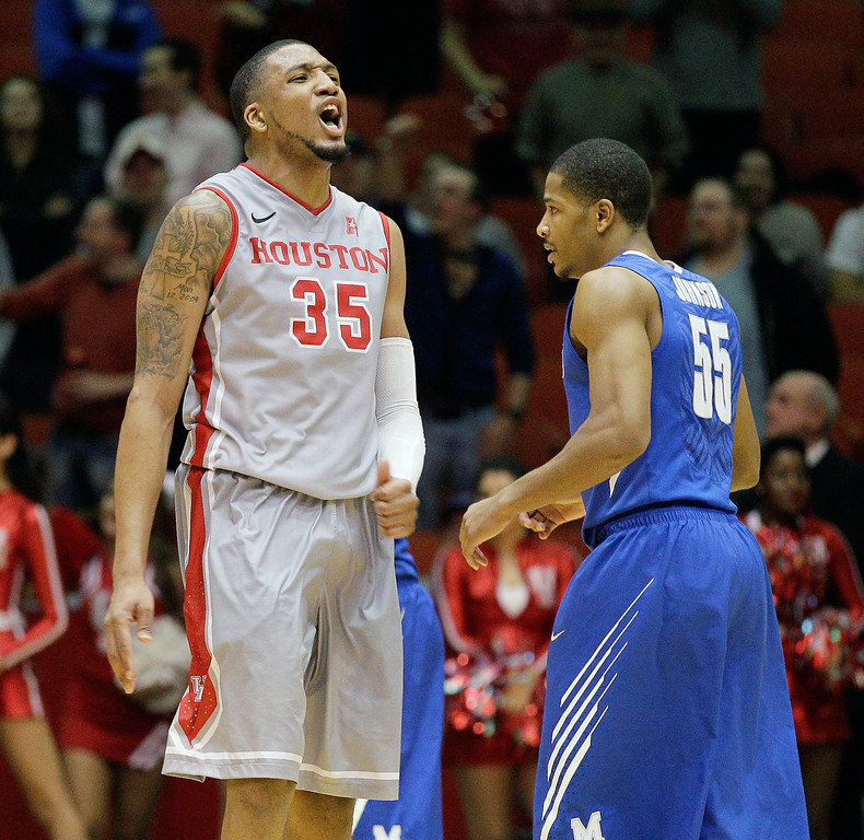 . Houston\'s forward TaShawn Thomas (35) reacts after grabbing a rebound late in the game as  Memphis\' Geron Johnson (55) looks on  during the second half of an NCAA college basketball game, Thursday, Feb. 27, 2014, in Houston. Houston won 77-68. (AP Photo/Bob Levey)