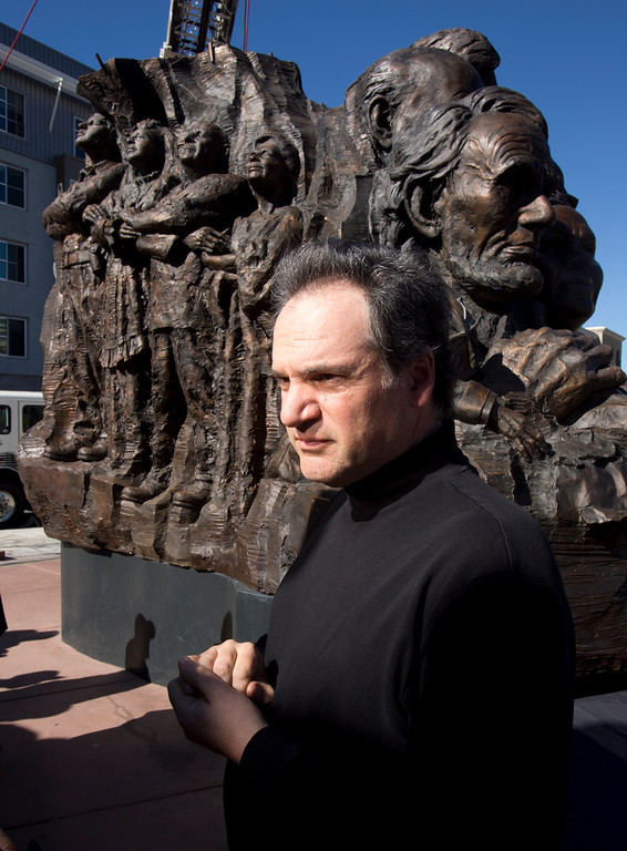 """. Mario Chiodo, the artist behind \""""Remember Them,\"""" stands by his paean to heroes of civil rights and humanity before the start of a ceremony to dedicate the section for 9/11 first responders and firefighters in general, Thursday, Feb. 21, 2013 in Oakland Calif. (D. Ross Cameron/Staff)"""