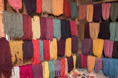 Wool in multiple colors hanging on drying racks