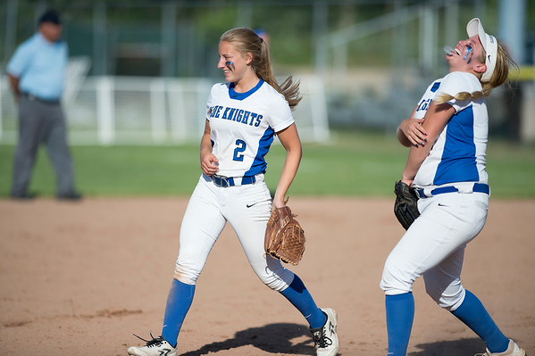 06/03/19 Wesley Bunnell   Staff Southington softball defeated Trumbull in a semifinal Class LL game at DeLuca Field in Stratford on Monday afternoon. Chrisala Marotto (2) jokes with Abby Lamson (17) between innings.