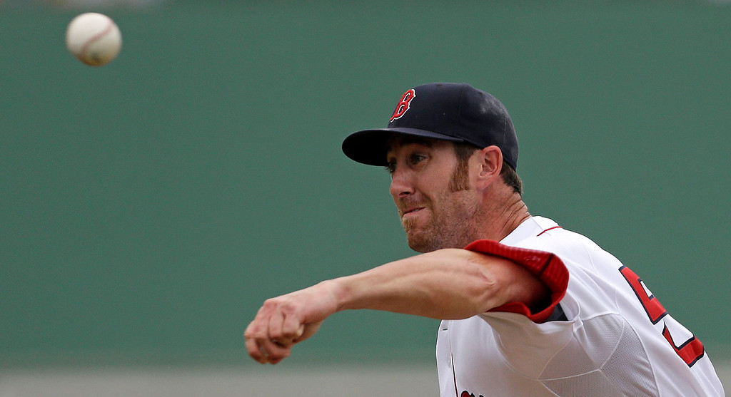 . Boston Red Sox pitcher Tommy Layne delivers during the seventh inning of a spring exhibition baseball game against the Minnesota Twins in Fort Myers, Fla., Saturday, March 29, 2014. The Twins won 7-4. (AP Photo/Gerald Herbert)