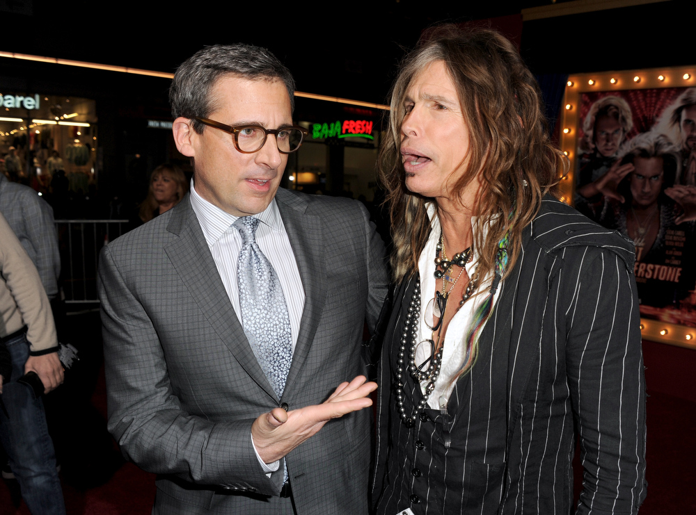 ". Actor/producer Steve Carell (L) and musician Steven Tyler attend the premiere of Warner Bros. Pictures\' ""The Incredible Burt Wonderstone\"" at TCL Chinese Theatre on March 11, 2013 in Hollywood, California.  (Photo by Kevin Winter/Getty Images)"