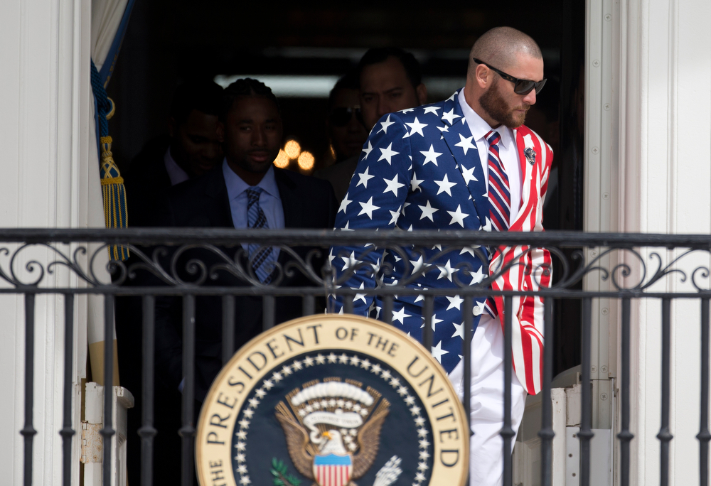 . Boston Red Sox outfielder Jonny Gomes, sporting an American flag blazer, arrives for a ceremony on the South Lawn of the White House in Washington, Tuesday, April 1, 2014, where President Barack Obama honored the 2013 World Series baseball champion Boston Red Sox. Gomes ordered American flag blazers as gifts for all of his Red Sox teammates, but didn�t think he was providing a uniform for today�s White House visit.  (AP Photo/Carolyn Kaster)