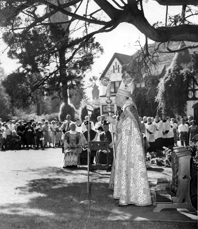 . August 29, 1949 - Archbishop John J. Mitty bestows a special blessing upon the new Sisters of the Holy Family at Mission San Jose. The blessings were given to the archbisop on his audience with Pope Pius in Rome. (Oakland Tribune Staff Archives)
