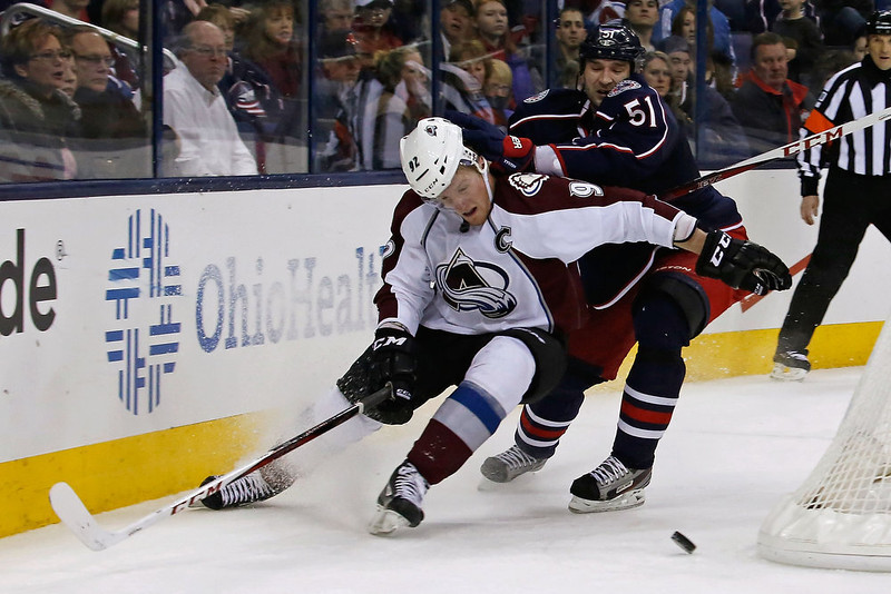 . Gabriel Landeskog #92 of the Colorado Avalanche is checked by Fedor Tyutin #51 of the Columbus Blue Jackets while chasing after a loose puck during the third period on March 3, 2013 at Nationwide Arena in Columbus, Ohio. Columbus defeated Colorado 2-1 in overtime. (Photo by Kirk Irwin/Getty Images)
