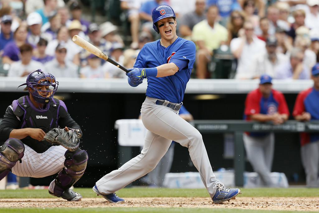 . Chicago Cubs left fielder Chris Coghlan reacts in pain after fouling off a pitch against the Colorado Rockies at Coors Field on August 7, 2014 in Denver, Colorado.  The Chicago Cubs defeated the Colorado Rockies 6-2. (Photo by Trevor Brown, Jr./Getty Images)