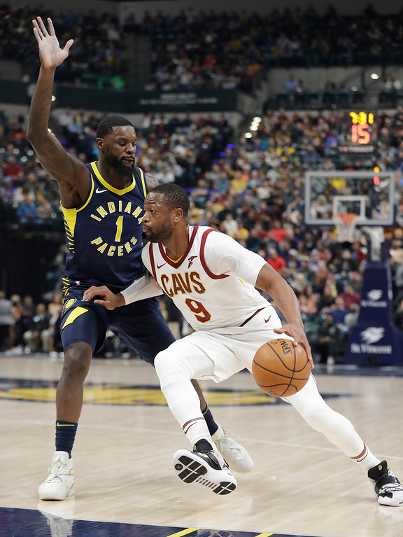 . Cleveland Cavaliers\' Dwyane Wade (9) goes to the basket against Indiana Pacers\' Lance Stephenson during the first half of an NBA basketball game Friday, Dec. 8, 2017, in Indianapolis. (AP Photo/Darron Cummings)
