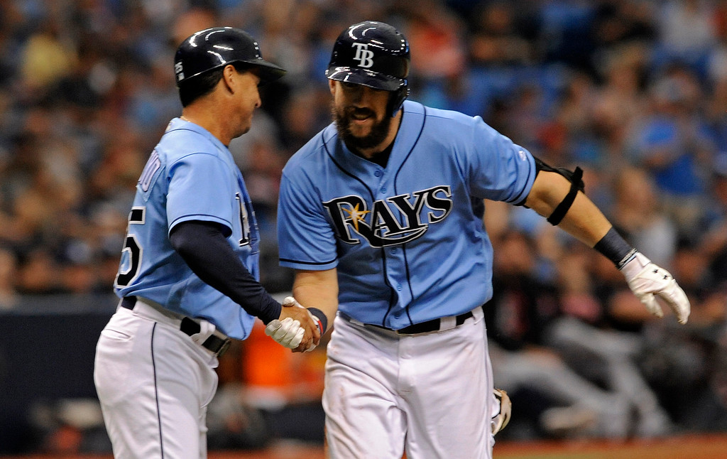 . Tampa Bay Rays third base coach Charlie Montoyo, left, congratulates Steven Souza Jr., right, after his two-run home run off Cleveland Indians starter Corey Kluber during the inning of a baseball game, Sunday, Aug. 13, 2017, in St. Petersburg, Fla. (AP Photo/Steve Nesius)