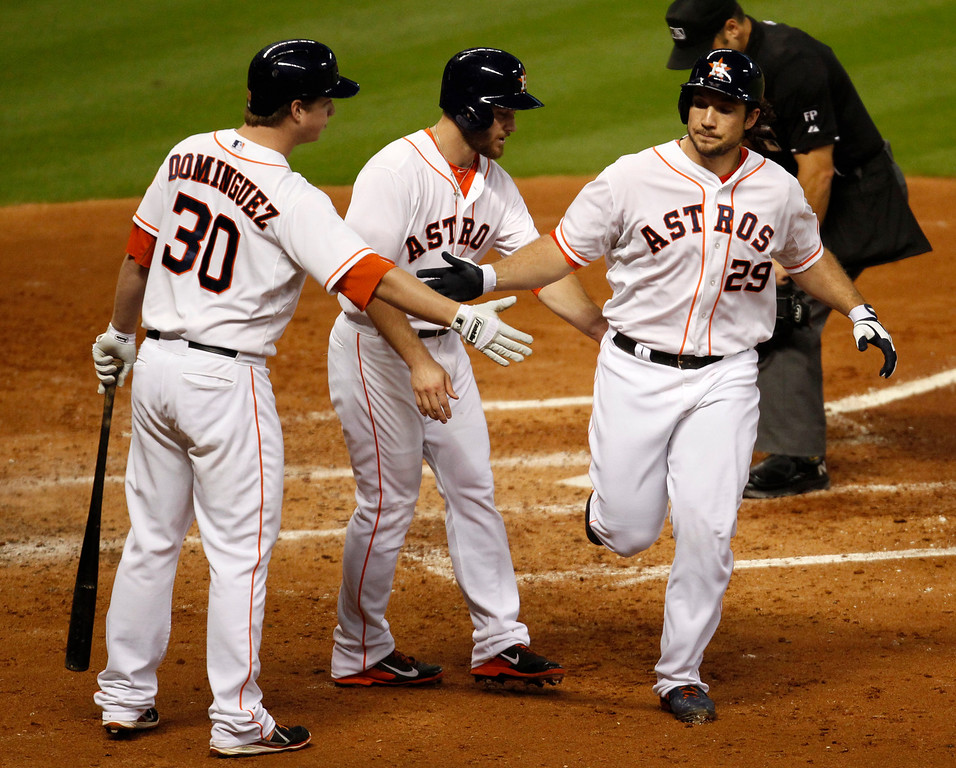 . Houston Astros Brett Wallace, (29) is congratulated by teammates Matt Dominguez, (30) and Trevor Crowe after hitting a two-run home run in the fourth inning of a baseball game against the Los Angeles Angels Saturday, Sept. 14, 2013 at Minute Maid Park in Houston. (AP Photo/Eric Christian Smith)