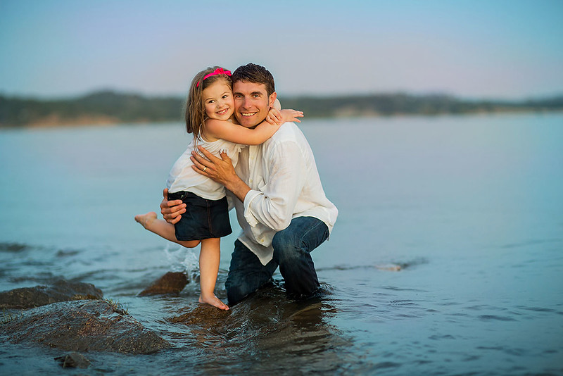 Sacramento family photographer during outdoor portrait session. Family session by a river..