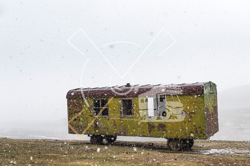 Mysterious abandoned old green train wagon in a snowstorm on the Seok Pass