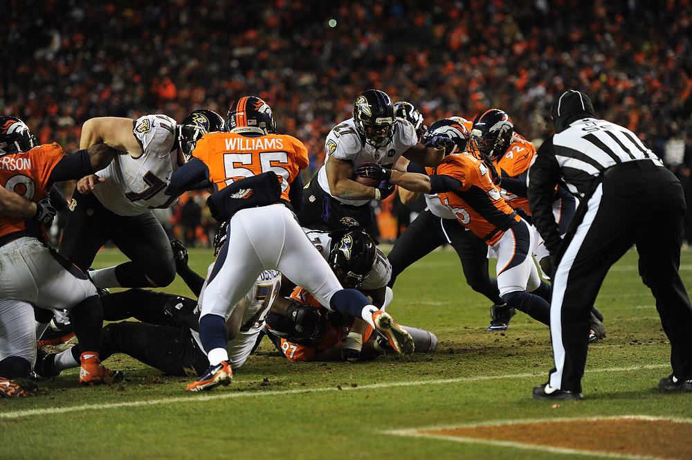 . Baltimore Ravens running back Ray Rice (27) is stopped at the one yard line. The Denver Broncos vs Baltimore Ravens AFC Divisional playoff game at Sports Authority Field Saturday January 12, 2013. (Photo by Joe Amon,/The Denver Post)