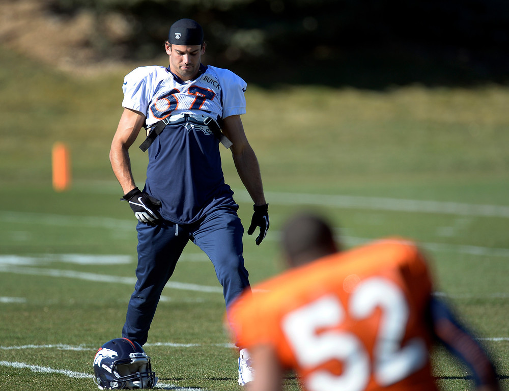 . Denver Broncos wide receiver Eric Decker (87) stretches before practice November 20, 2013 at Dove Valley (Photo by John Leyba/The Denver Post)