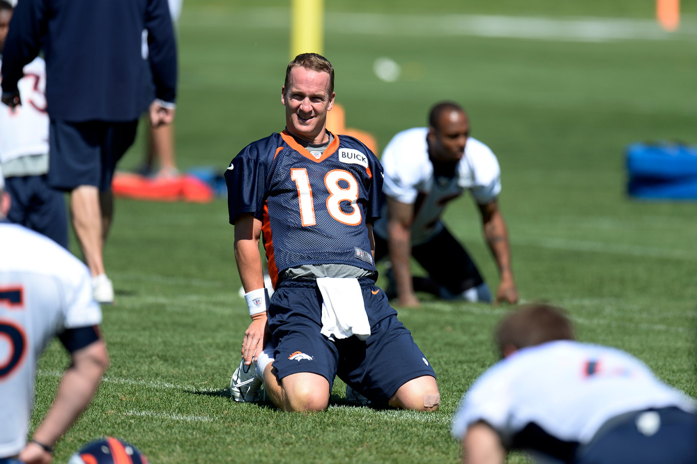 . Quarterback Peyton Manning (18) of the Denver Broncos stretches during OTAs June 6, 2013 at Dove Valley. (Photo By John Leyba/The Denver Post)