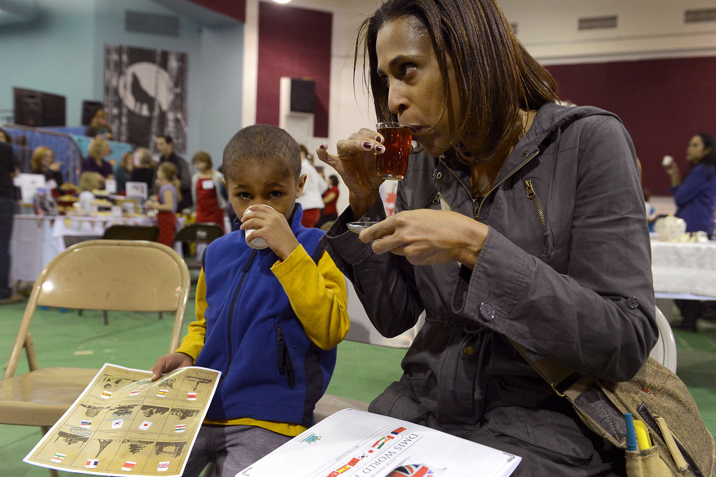 . DENVER, CO. - JANUARY 27: Tea enthusiast Nicolas Collins 6-years-old and Sandra Thebaud 44-years-old  taste tea from Turkey during the World Tea Fair at Denver Montclair International School January 27, 2013. There were 12 tables featuring tea samples from around the World.(Photo By John Leyba / The Denver Post)