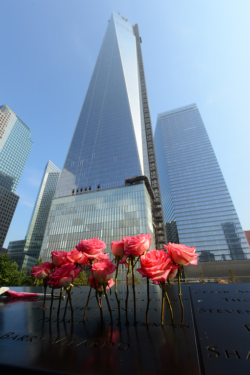 . Flowers stand in a name at the at the 9/11 Memorial during ceremonies for the twelfth anniversary of the terrorist attacks on lower Manhattan at the World Trade Center site on September 11, 2013 in New York City.  (Photo by David Handschuh-Pool/Getty Images)