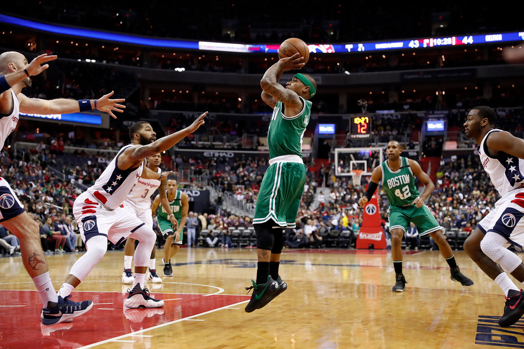 . Boston Celtics guard Isaiah Thomas (4) shoots between Washington Wizards center Marcin Gortat, left, from Poland, forward Markieff Morris, guard Bradley Beal, and guard John Wall, right, during the second half of Game 6 of an NBA basketball second-round playoff series, Friday, May 12, 2017, in Washington. The Wizards won 92-91. (AP Photo/Alex Brandon)