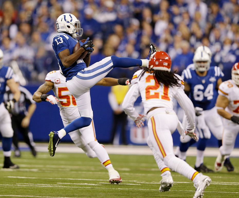 . Indianapolis Colts wide receiver T.Y. Hilton (13) makes a catch as Kansas City Chiefs cornerback Dunta Robinson (21) moves in to defend during the first half of an NFL wild-card playoff football game Saturday, Jan. 4, 2014, in Indianapolis. (AP Photo/Michael Conroy)