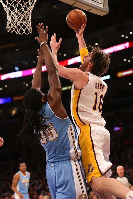 . Pau Gasol #16 of the Los Angeles Lakers shoots over Kenneth Faried #35 of the Denver Nuggets at Staples Center on January 6, 2013 in Los Angeles, California.   (Photo by Stephen Dunn/Getty Images)