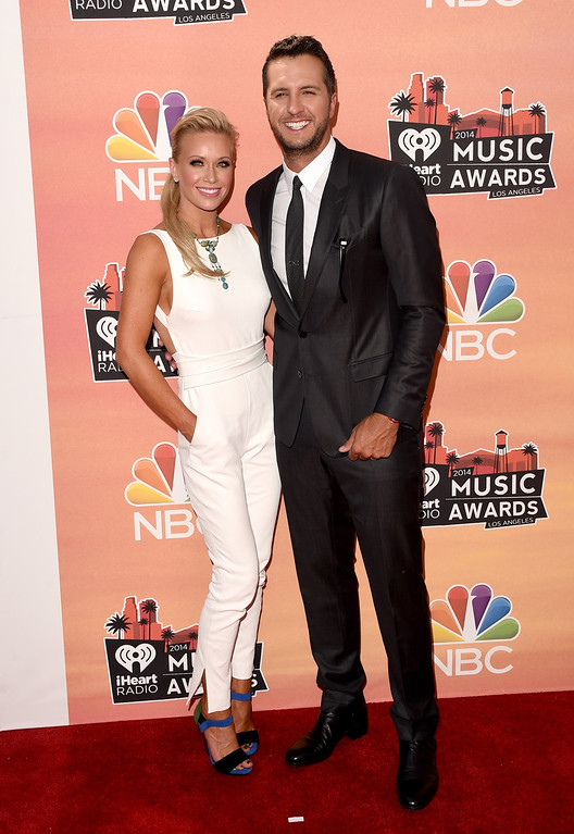 . LOS ANGELES, CA - MAY 01:  Caroline Bryan (L) and recording artist Luke Bryan attend the 2014 iHeartRadio Music Awards held at The Shrine Auditorium on May 1, 2014 in Los Angeles, California. iHeartRadio Music Awards are being broadcast live on NBC.  (Photo by Jason Merritt/Getty Images for Clear Channel)