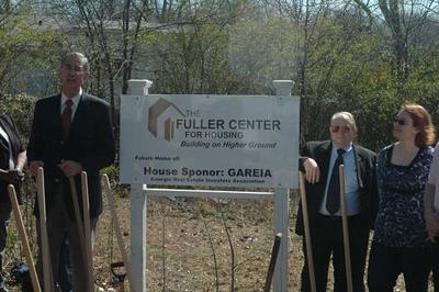 Millard Fuller, John Parker (FP City Manager), Andrea Clayton (representing Goldmine Properties who donated lot