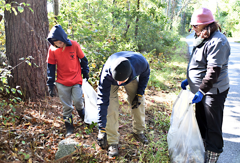 Dracut community clean-up along Coburn Road, shown here L-R, Cullen Soucy 12 from BS Troop 80 Dracut, Chris Soucy and Shannon Soucy both from Crew 308 and Loundonderry NH. SUN/David H.Brow