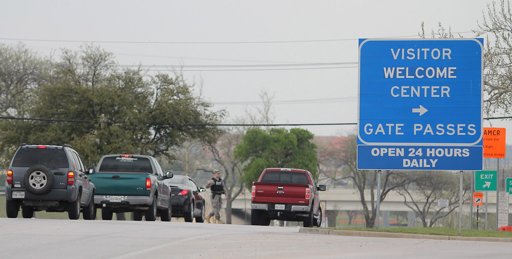 . Motorists stop at the entrance to the Bernie Main Gate of Fort Hood, Texas, Wednesday, April 2, 2014, after a shooting occurred on the military base. (AP Photo/The Killeen Daily Herald, Catrina Rawson)