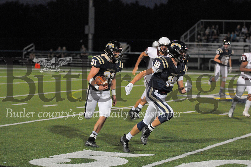 Freeport #10 Luke Miller runs to block for #31 Ricky Hunter verses Uniontown during a game at Freeport Stadium on Friday September 20, 2019 (Jason Swanson photo)