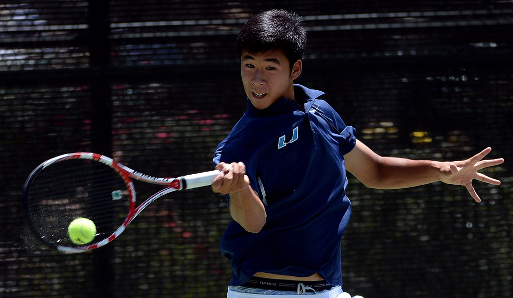. University\'s (Irvine) Eric Tseng returns a shot by San Marino\'s Ryan Cheng (not pictured) during the CIF State Tennis Championship at the Claremont Club in Claremont, Calif., on Saturday, May 31, 2014.   (Keith Birmingham/Pasadena Star-News)