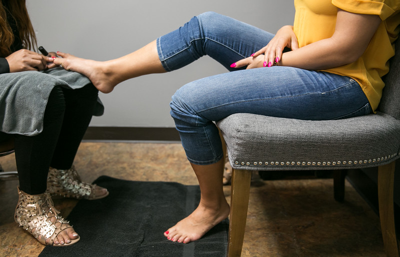 White Diamond Image Consulting offers more than standard salon offerings not only hair, makeup and nail services but also before and after photography shoots, neck massage, tea and extra pampering for women only.  Nicole Castoreno, a mother of two, gets a Mommy Makeover with Cherise B Thomas doing her hair, Treva D Cameron taking care of her manicure and pedicure and make up by Shirley Adrien at the salon.   (Jenni Girtman / Atlanta Event Photography)