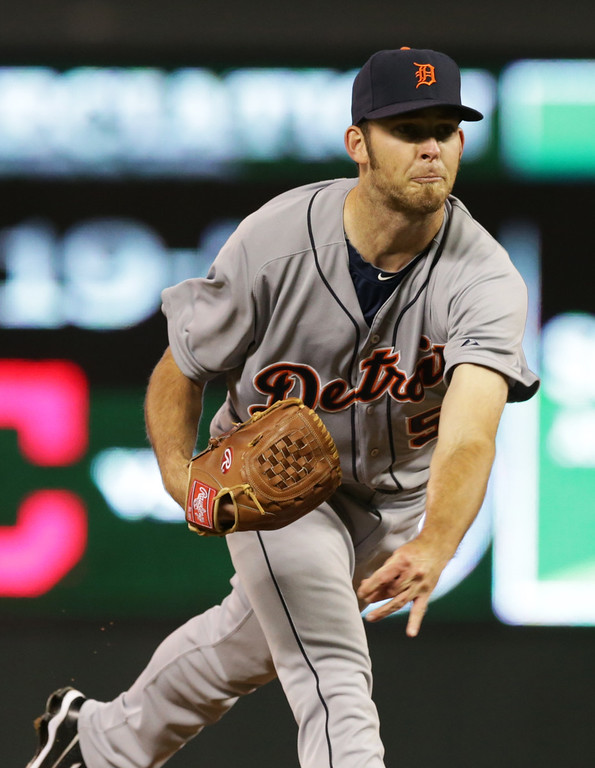 . Detroit Tigers pitcher Kyle Ryan follows through on a pitch against the Minnesota Twins in the eighth inning of a baseball game, Monday, Sept. 15, 2014, in Minneapolis. The Tigers won 8-6, with ryan picking up the win. (AP Photo/Jim Mone)