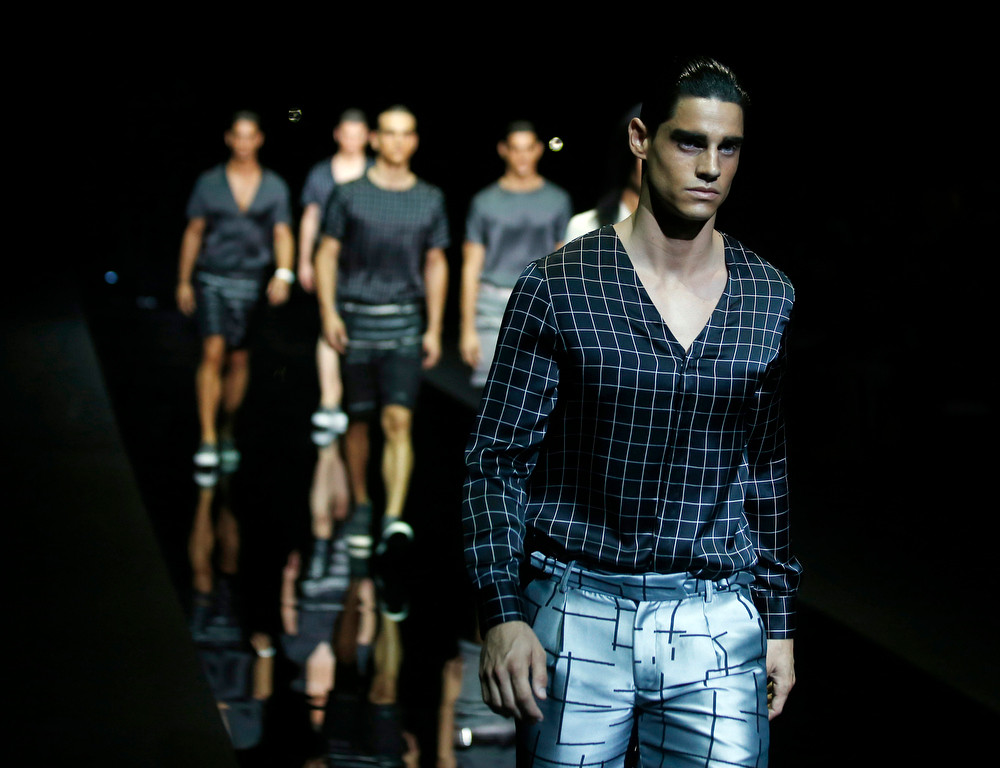 . Models wear creations for Emporio Armani men\'s Spring-Summer 2015 collection, part of the Milan Fashion Week, unveiled in Milan, Italy, Monday, June 23, 2014. (AP Photo/Luca Bruno)