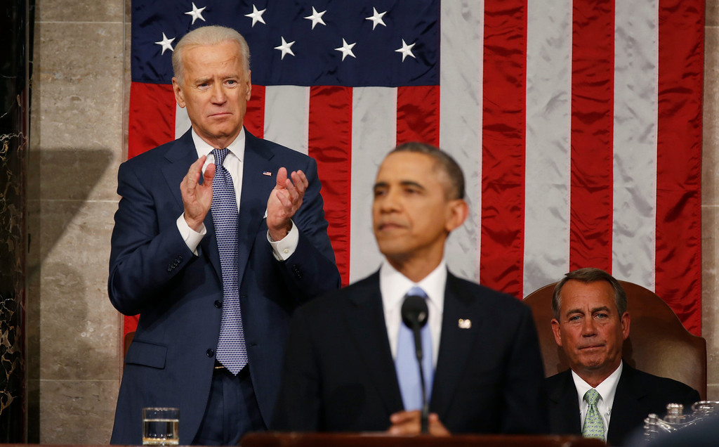 . President Barack Obama pauses as he gives the State of Union address before a joint session of Congress in the House chamber Tuesday, Jan. 28, 2014, in Washington, as Vice President Joe Biden, applauds and House Speaker John Boehner of Ohio, listens. (AP Photo/Larry Downing, Pool)