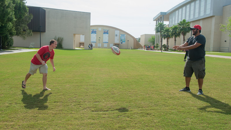 Rugby club members Rickey Black (Left) and Christian Rosado pass the ball back and forth on the East Lawn.
