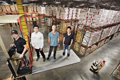Flexe executives are pictured in client Funworld West's massive 380,000 square foot warehouse in Sumner, Washington
