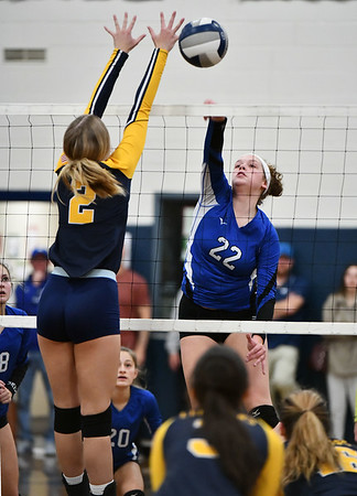 11/16/2019 Mike Orazzi | StaffrBristol Easterns Hannah Webber (22) Woodstock Academy's Amelia Large (2) during the 2019 State Girls Volleyball Tournament Class L Quarterfinals at BEHS in Bristol Saturday. r