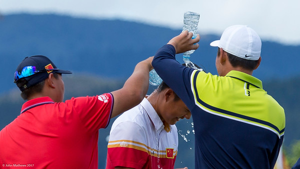 Fellow competitors drench Yuxin Lin from China after he won the Asia-Pacific Amateur Championship tournament 2017 held at Royal Wellington Golf Club, in Heretaunga, Upper Hutt, New Zealand from 26 - 29 October 2017. Copyright John Mathews 2017.   www.megasportmedia.co.nz