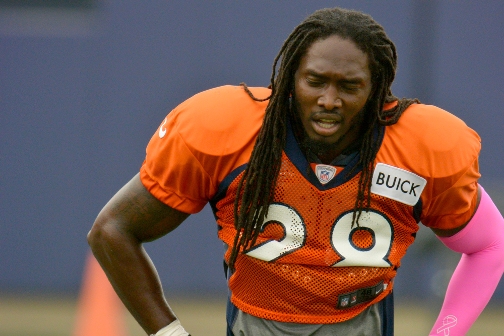 . Denver Broncos SS Quinton Carter (28) takes a breather during training camp July 29, 2013 at Dove Valley. (Photo By John Leyba/The Denver Post)