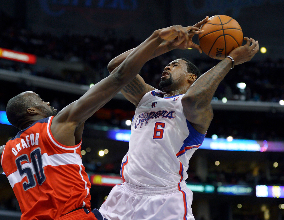 . Washington Wizards center Emeka Okafor, left, blocks the shot of Los Angeles Clippers center DeAndre Jordan during the first half of their NBA basketball game, Saturday, Jan. 19, 2013, in Los Angeles.  (AP Photo/Mark J. Terrill)