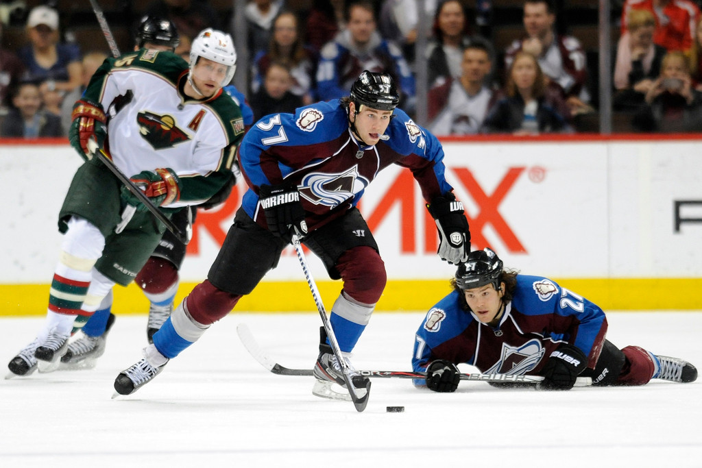 . Colorado Avalanche center Ryan O\'Reilly (37) controls the puck against the Minnesota Wild during the third period of the Avs\' 7-1 win on Tuesday, March 6, 2012. 2012. AAron Ontiveroz, The Denver Post