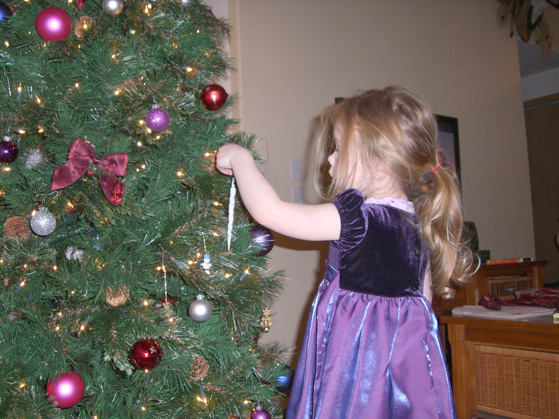 Helping to decorate the Christmas tree. Most of her stuff went in a 2 foot radius. :)