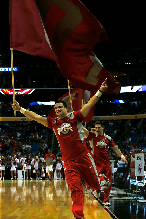 . Ohio State cheerleaders work the crowd before the start of a second-round game of the NCAA college basketball tournament against Dayton in Buffalo, N.Y., Thursday, March 20, 2014.  (AP Photo/The Buffalo News, Robert Kirkham)