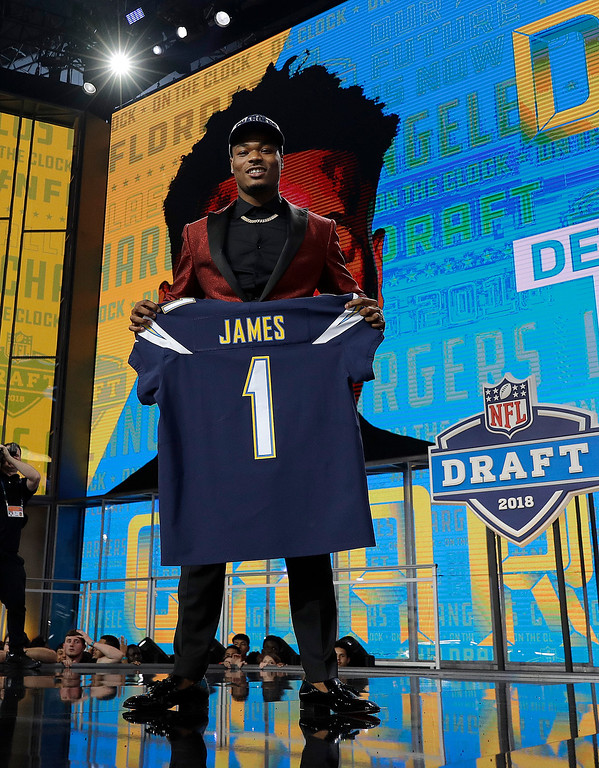 . Florida State\'s Derwin James poses with his Los Angeles Chargers team jersey during the first round of the NFL football draft, Thursday, April 26, 2018, in Arlington, Texas. (AP Photo/David J. Phillip)