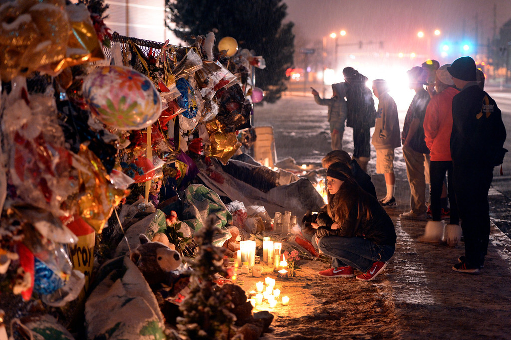 . CENTENNIAL, CO. - DECEMBER 21:  A steady stream of people payed their respects at the fence outside Arapahoe High School as news spread that Claire Davis passed away Saturday night, December 21, 2013. Photo By Karl Gehring/The Denver Post