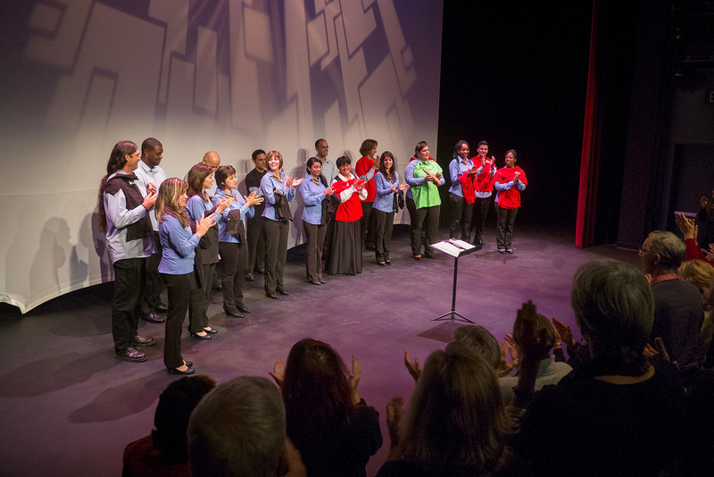Coro de Entrevoces with WHAT t-shirts as memento of visit (© 2012 by Michael and Suz Karchmer)